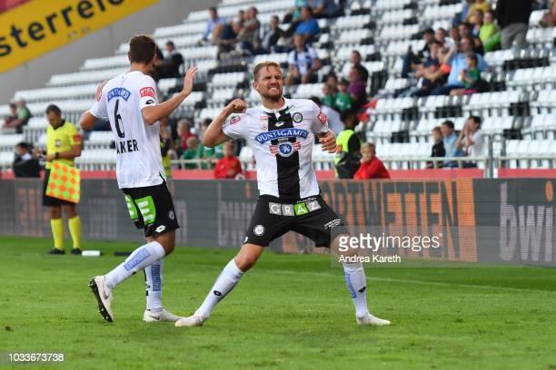 Markus Lackner of Sturm celebrates after scoring the third goal of his team with teammate Lukas Grozurek during the tipico Bundesliga match between...