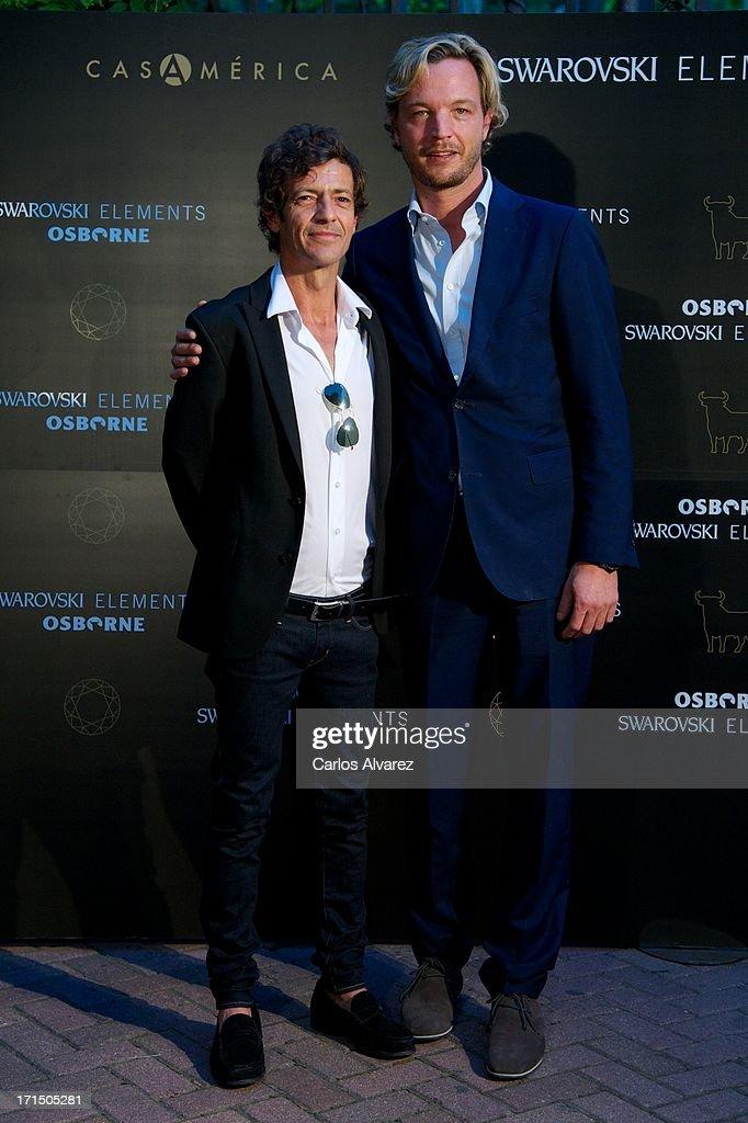 Markus Langes-Swarovski (R) and Willie Marquez (L) attend Swarovski-Osborne Bull illumination at the Casa America on June 25, 2013 in Madrid, Spain.