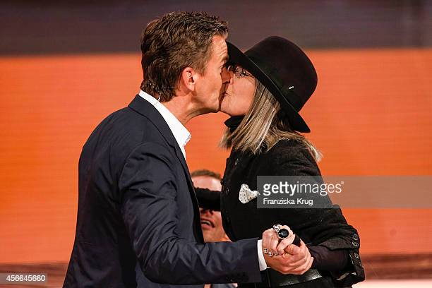 Markus Lanz and Diane Keaton share a kiss as they attend Wetten dass from Erfurt on October 04 2014 in Erfurt Germany