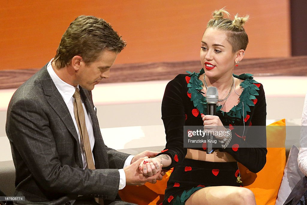 Markus Lanz and Miley Cyrus attend Wetten, dass..? tv show on November 09, 2013 in Halle an der Saale, Germany.