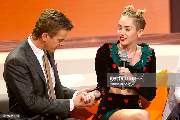 Markus Lanz and Miley Cyrus attend Wetten dass tv show on November 09 2013 in Halle an der Saale Germany