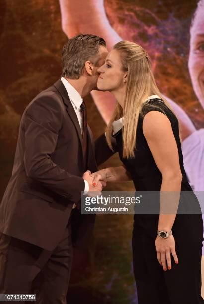 Markus Lanz greets Angelique Kerber on stage during the TV show 'Menschen 2018 der ZDF Jahresrueckblick' at Phoenixhof on December 17 2018 in Hamburg...