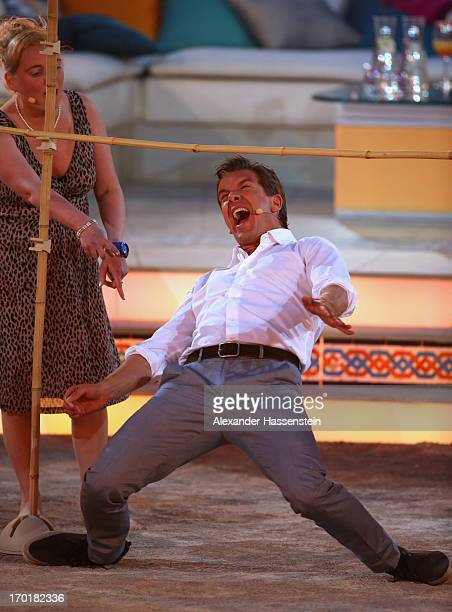 Markus Lanz performes a Limbo dance during the 'Wetten dass' TV show at Plaza de Toros de Palma Coliseo Balear on June 8 2013 in Palma de Mallorca...