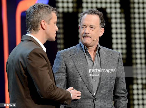 Markus Lanz welcome Tom Hanks during the 'Wetten dass..?' show on November 3, 2012 in Bremen, Germany.