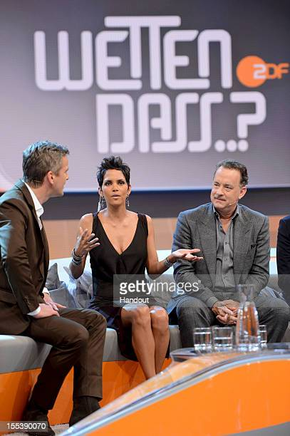 Markus Lanz welcomes Tom Hanks and Halle Berry during the 'Wetten dass' show on November 3 2012 in Bremen Germany