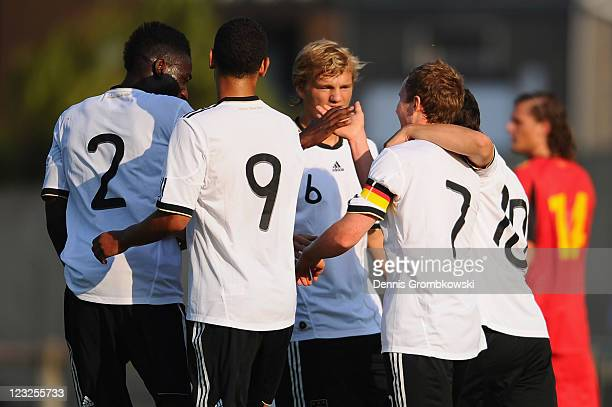 Markus Mendler of Germany celebrates after scoring his team's opening goal during the U19 International friendly match between Belgium and Germany at...