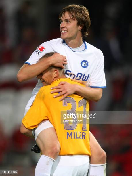 Markus Miller of Karlsruhe and team mate Sebastian Langkamp are seen after winning the Second Bundesliga match between FC Energie Cottbus and...