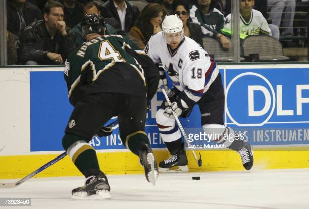 Markus Naslun of the Vancouver Canucks skates with the puck as Mattias Norstrom of the Dallas Stars defends during game three of the 2007 NHL Western...