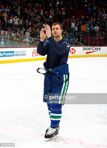 Markus Naslund applauds for the fans at the end of his last game as a Vancouver Canuck during their game against the Calgary Flames at General Motors...