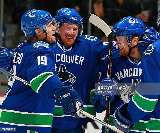 Markus Naslund Daniel Sedin and Henrik Sedin of the Vancouver Canucks celebrate a Canuck goal against the Edmonton Oilers during their game at...