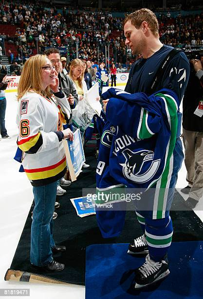 Markus Naslund gives his jersey to a fan during his last game as a Vancouver Canuck during their game against the Calgary Flames at General Motors...