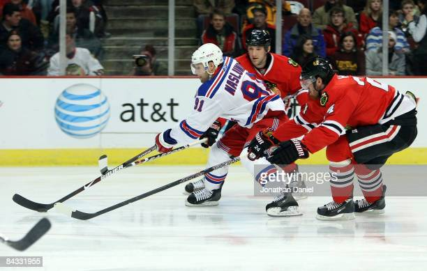 Markus Naslund of the New York Rangers skates between Martin Havlat and Cameron Barker of the Chicago Blackhawks on January 16 2009 at the United...