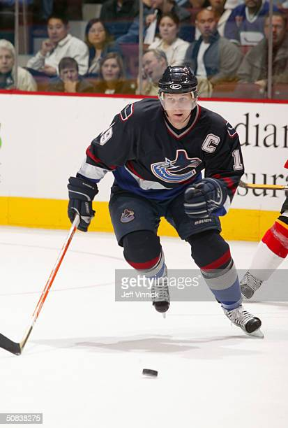 Markus Naslund of the Vancouver Canucks skates after the puck during the game against the Calgary Flames in the first round of the 2004 NHL Stanley...