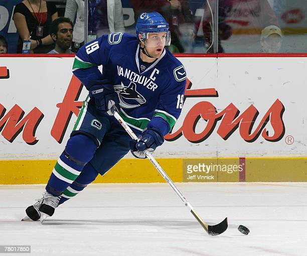 Markus Naslund of the Vancouver Canucks skates up the ice with the puck during their game against the Calgary Flames at General Motors Place on...