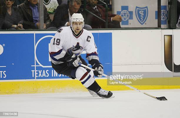 Markus Naslund of the Vancouver Canucks skates with the puck against the Dallas Stars during game three of the 2007 NHL Western Conference...