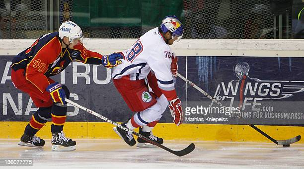 Markus Nordlund of Jokerit and Akim Aliu of Salzburg battle for the puck during the Red Bulls Salute Final match between EC Red Bull Salzburg and...