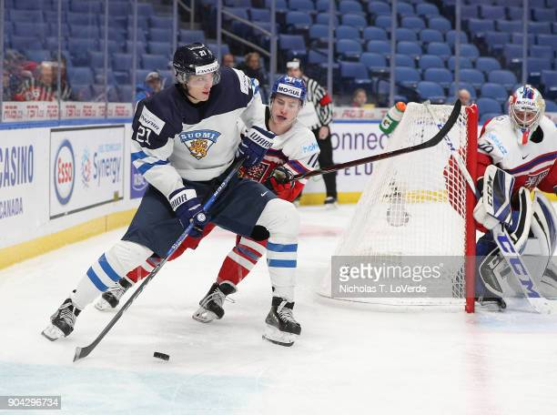 Markus Nurmi of Finland skates the puck against Filip Král of Czech Republic during the second period of play in the IIHF World Junior Championships...