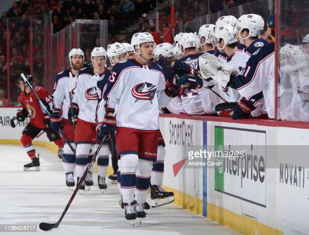 Markus Nutivaara high fives the bench after scoring a first period against the Ottawa Senators the Columbus Blue Jackets at Canadian Tire Centre on...