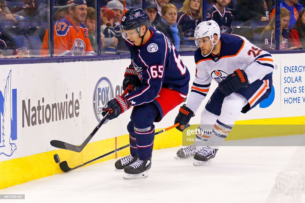 Markus Nutivaara #65 of the Columbus Blue Jackets and Leon Draisaitl #29 of the Edmonton Oilers battle for control of the puck during the third period on December 12, 2017 at Nationwide Arena in Columbus, Ohio. Edmonton defeated Columbus 7-2.