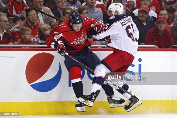 Markus Nutivaara of the Columbus Blue Jackets checks Dmitry Orlov of the Washington Capitals in the first period in Game One of the Eastern...