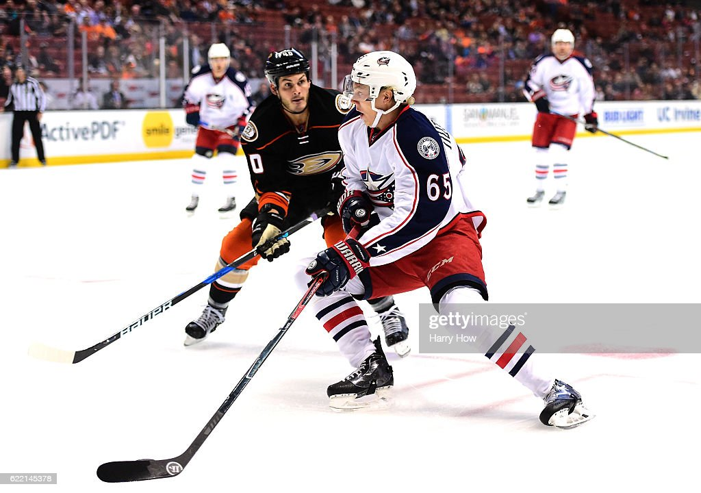 Markus Nutivaara #65 of the Columbus Blue Jackets cuts to the net as he is chased by Jared Boll #40 of the Anaheim Ducks at Honda Center on October 28, 2016 in Anaheim, California.