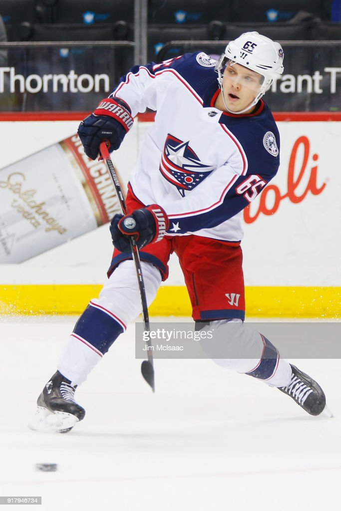 Markus Nutivaara #65 of the Columbus Blue Jackets passes the puck during the first period against the New York Islanders at Barclays Center on February 13, 2018 in New York City.