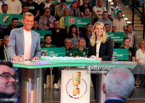 Markus Othmer ARD moderator and Nia Kuenzer former player of Germany smile during the DFB Cup 2019/20 First Round Draw at Deutsches Fussballmuseum on...