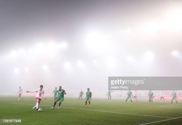 Markus Palionis of Jahn Regensburg is challenged by Simon Falette of Hannover 96 during the Second Bundesliga match between SSV Jahn Regensburg and...