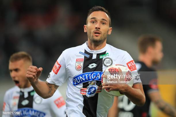 Markus Pink of Sturm Graz celebrates after scoring the equalizer during the tipico Bundesliga match between Wolfsberger AC and Sturm Graz at...