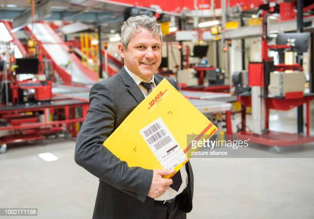 Markus Reckling the German CEO of logistics company DHL Express smiling at an Express station in Hamburg Germany 18 May 2017 DHL has a new Express...