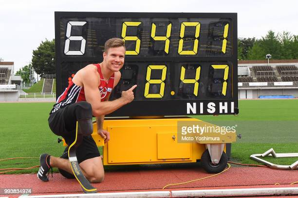 Markus Rehm of Germany poses for photographs with the display showing the new world record of 8m47 in the Men's Long Jump F64 during day two of the...