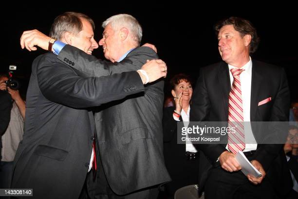 Markus Ritterbach vicepresident Werner Spinner president and Toni Schumacher vicepresident celebrate after bein voted during the extraordinary...