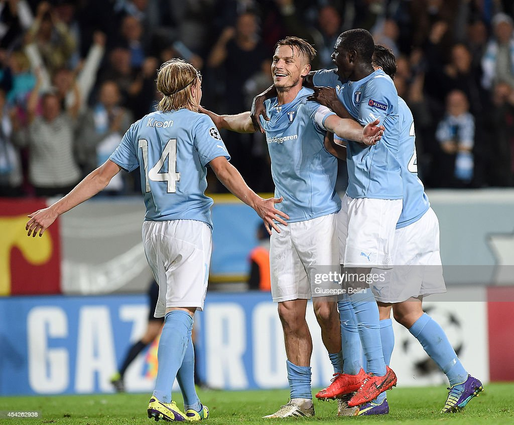 Markus Rosenber of Malmo celebrates after scoring the goal 3-0 during UEFA Champions League qualifying play-offs round second leg match between Malmo FF and Red Bull Salzburg on August 27, 2014 in Malmo, Sweden.