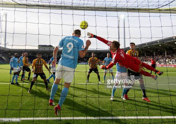 Markus Rosenberg and Johan Dahlin of Malmo FF makes a save during the Allsvenskan match between BK Hacken and Malmo FF at Bravida Arena on October 7...