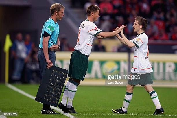 Markus Rosenberg of Bremen attends the pitch for team mate Marko Marin during the Bundesliga match between Bayer Leverkusen and Werder Bremen at...
