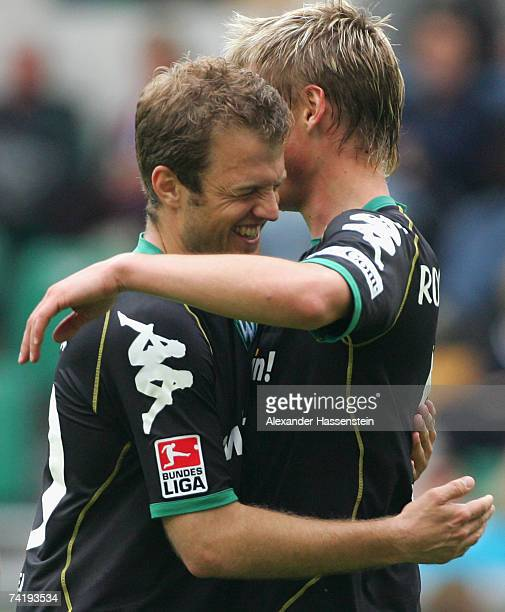 Markus Rosenberg of Bremen celebrates scoring the second goal with his team mate Daniel Jensen during the Bundesliga match between VFL Wolfsburg and...