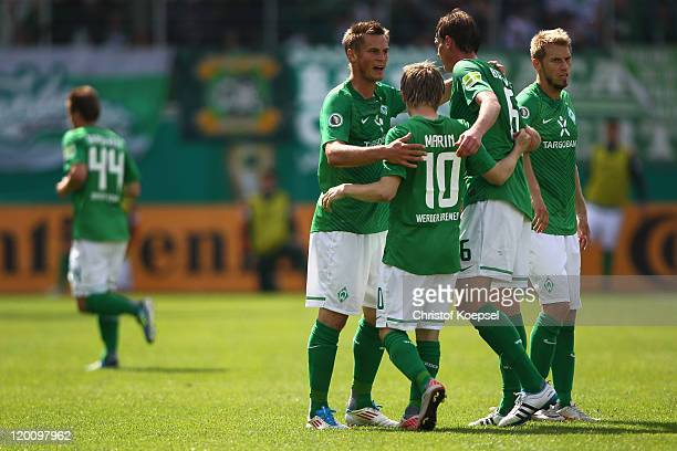 Markus Rosenberg of Bremen celebrates the first goal with Marko Marin Tim Borowski and Aaron Hunt of Bremen during the first round DFB Cup match...