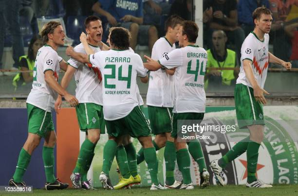 Markus Rosenberg of Bremen celebrates with his team mates after scoring his team's first goal during the Uefa Champions League qualifying second leg...