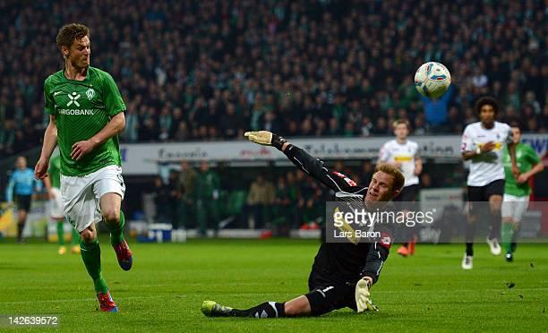 Markus Rosenberg of Bremen scores his teams first goal against goalkeeper Marc Andre ter Stegen during the Bundesliga match between SV Werder Bremen...