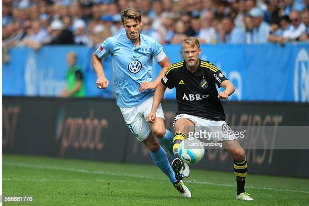 Markus Rosenberg of Malmo FF and Daniel Sundgren of AIK during the Allsvenskan match between Malmo FF and AIK at Swedbank Stadion on August 7 2016 in...