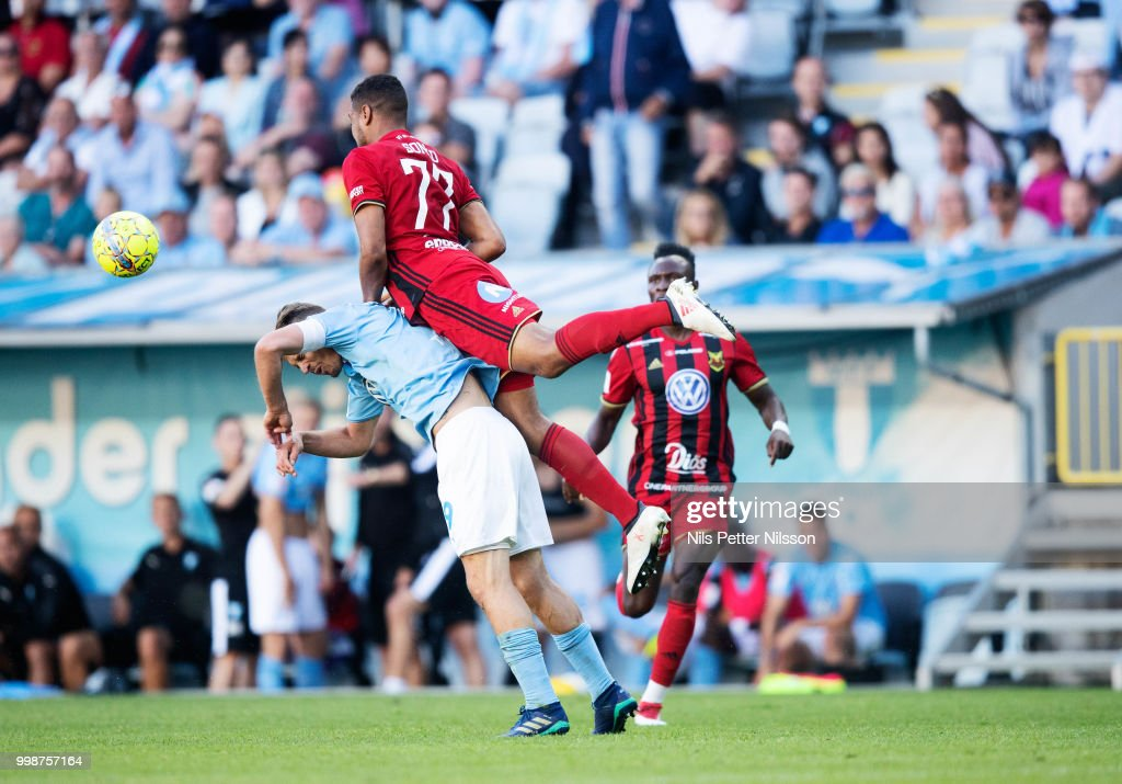Markus Rosenberg of Malmo FF is tackled by Noah Sonko Sundberg of Ostersunds FK during the Allsvenskan match between Malmo FF and Ostersunds FK at Malmo Stadion on July 14, 2018 in Malmo, Sweden.