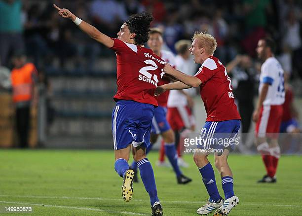 Markus Schwabl of Unterhaching celebrates with team mate Sascha Bigalke after scoring his team's fourth goal during the Third League match between...