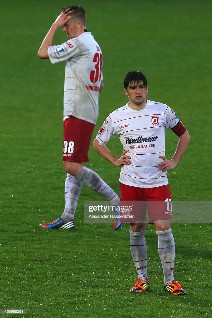 Markus Smarzoch (R) of Regensburg reacts with his team mate Philipp Ziereis after the Second Bundesligamatch between Jahn Regensburg and FC Ingolstadt at Jahnstadion on April 19, 2013 in Regensburg, Germany.