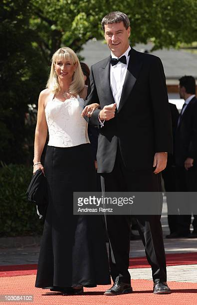 Markus Soeder and his wife Karin BaumuellerSoeder arrive at the 'Festspielhaus' ahead of the opening performance of 'Lohengrin' at the Richard Wagner...
