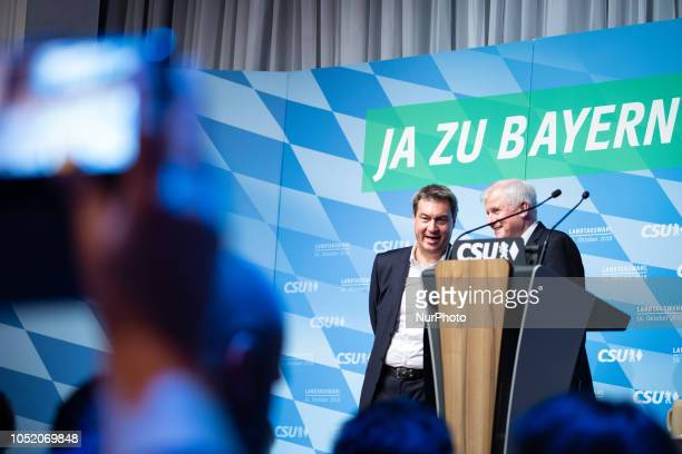 Markus Soeder and Horst Seehofer joking on the stage The Christian Social Union held its last rally in the Loewenbraeukeller before the Bavarian...