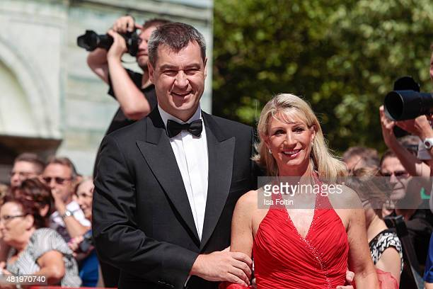 Markus Soeder and Karin Baumueller attend the Bayreuth Festival 2015 Opening on July 25 2015 in Bayreuth Germany