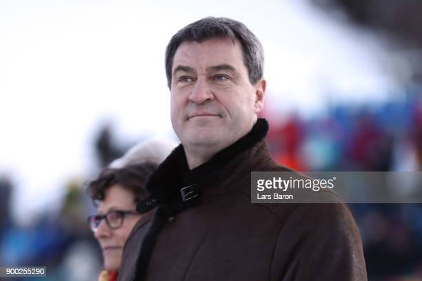 Markus Soeder Bavarian finance minister looks on during the final round on day 4 of the FIS Nordic World Cup Four Hills Tournament ski jumping event...