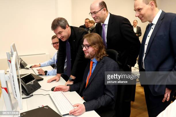 Markus Soeder Bavarian minister of finance Albert Fueracker state secretary of finance and Daniel Kleffel head of the Bavarian office for security...