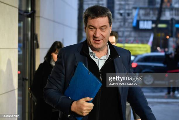 Markus Soeder designated State Premier of Bavaria and politician of the conservative Christian Social Union party arrives for talks with the leaders...