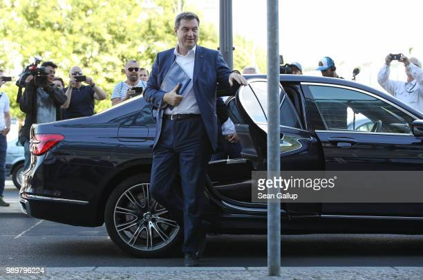 Markus Soeder Governor of Bavaria and a leading member of the Bavarian Social Union arrives shortly before Horst Seehofer German Interior Minister...